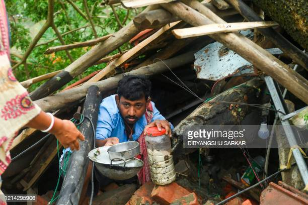 TOPSHOT Villagers salvage items from their house damaged by cyclone Amphan in Midnapore West Bengal on May 21 2020 The strongest cyclone in decades...