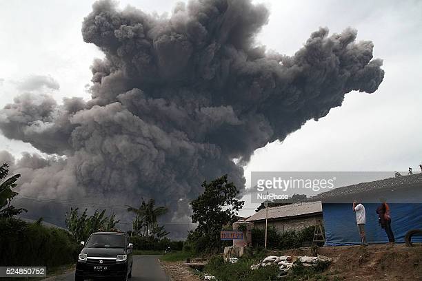 Villagers saw Mount Sinabung spews volcanic ash giant spitting into the sky as seen covering the Tiga Pancur village Karo North Sumatra Indonesia on...