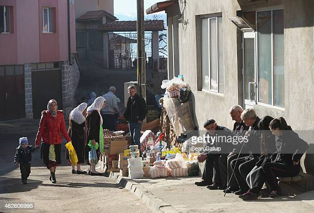 Villagers shop and congregate on market day on January 10 2014 in Ribnovo Bulgaria According to locals jobs were common in the region until the...