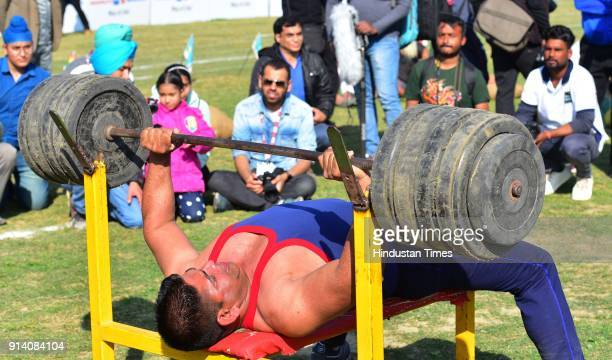 Villagers showing the strength on the 2nd day of the 82nd Kila Raipur Rural Olympics 2018 in the village Kila Raipur on February 3 in Ludhiana India...