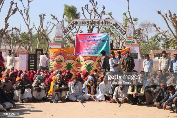 Villagers sit in a protest against privatisation of Shaheed Surjaram Government School Deeppura Rajaji on December 18 2017 in Sikar India The...