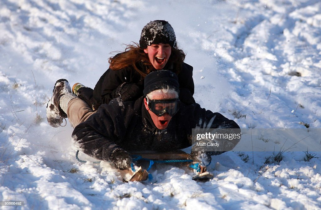Villagers sledge down a snow covered hill in Priston on January 9 2010, near Bath, England. Britain is continuing to be gripped by the Arctic weather and forecasters are predicting more snow in the next 24hrs and that the cold spell could last for at least another week.