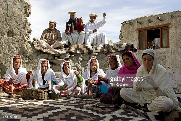 Villagers spin wool and knit together in mountain village of Altit in Karokoram Mountains Pakistan