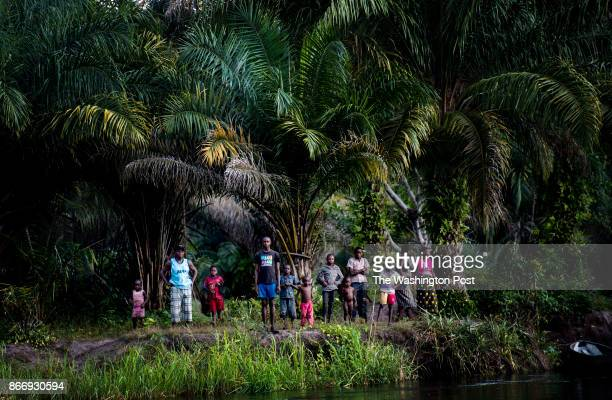 CONGO Villagers stand along the Motaba River in the remote north eastern area of the Republic of Congo in the Dongou area Republic of Congo Tuesday...