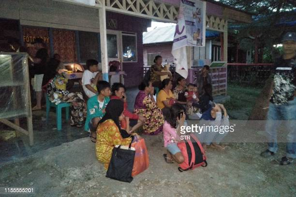 Villagers stay out of their homes following 73 magnitude earthquake in Labuha North Maluku on July 14 2019 A major 73magnitude earthquake hit the...