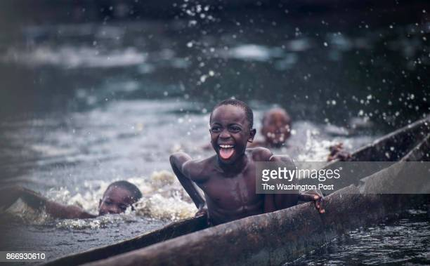CONGO Villagers swim and play along the Oubangui River in the remote north eastern area of the Republic of Congo in the Impfondo area Republic of...