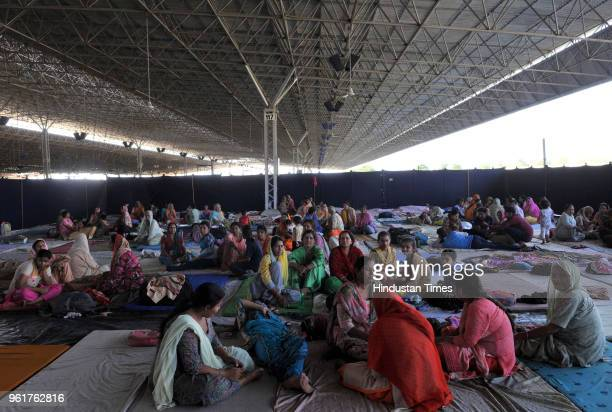 Villagers take shelter at a relief camp during shelling from the Pakistani side of the border near Vijaypur on May 23 2018 about 25 KM from Jammu...