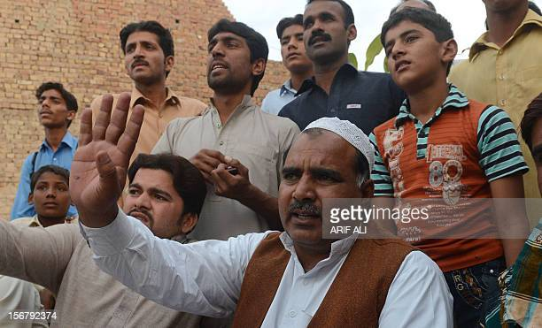 Villagers talk to media representatives following the execution of Ajmal Kasab who was hanged in an Indian prison at Kasab's village in Farid kot...