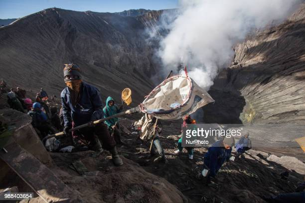 Villagers try to catch Tenggerese sacrifation that thrown to the volcano during Yadnya Kasada Festival at Mount Bromo Probolinggo East Java on 30th...