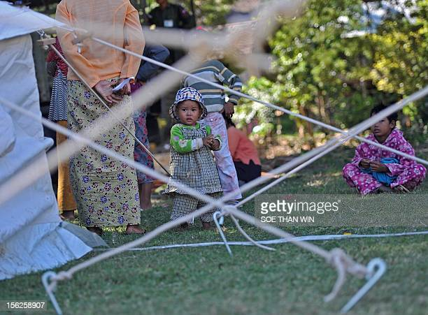 Villagers victim of recent earthquake stand at their camp in Thabeik Kyin township Mandalay a division in central Myanmar on November 12 2012...