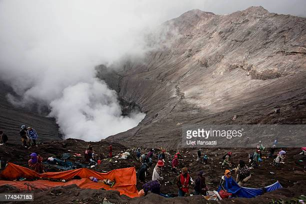 Villagers wait to catch offerings thrown by Hindu worshippers at the crater of Mount Bromo during the Yadnya Kasada Festival at crater of Mount Bromo...