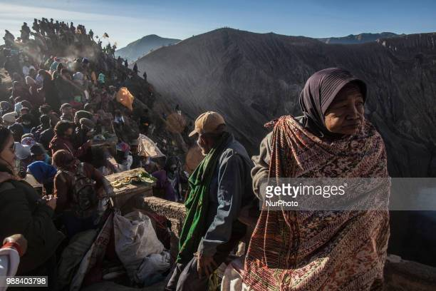 Villagers waiting for Tenggerese sacrifation that thrown to the volcano during Yadnya Kasada Festival at Mount Bromo Probolinggo East Java on 30th...