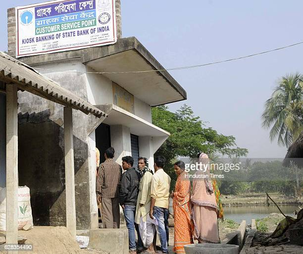 Villagers waiting in the queue at the customer service point of SBI Laxbagan Satjelia island on December 5 2016 Sunderban India Since demonetization...