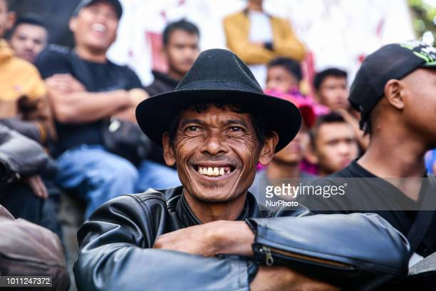 Villagers watch rams fight during a Sundanese traditional cultural event called Adu Domba Garut at Rancabango village in Garut West Java Indonesia on...