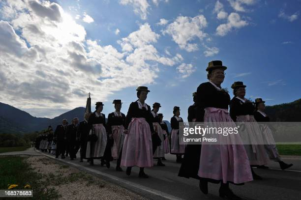 Villagers wearing Bavarian folk costumes specific to the Chiemsee region of southern Bavaria participate in the annual Ascension Day procession on...