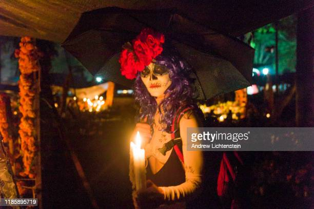 Villages celebrate the annual Day of the Dead on November 1 2019 in Michoacan Mexico Dia de los Muertos is a holiday combing Catholicism with...