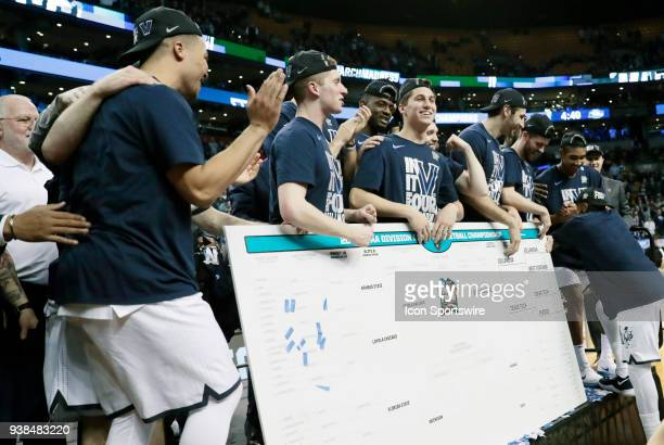 Villanova celebrates with the bracket after an Elite Eight matchup between the Villanova Wildcats and the Texas Tech Red Raiders on March 25 at TD...