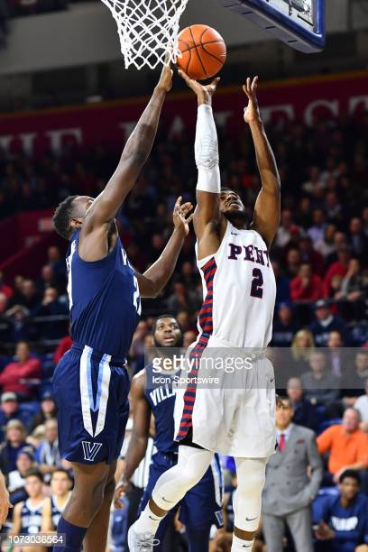 Villanova Forward Dhamir CosbyRoundtree defends a shot from Penn Guard Antonio Woods in the first half during the game between the Penn Quakers and...