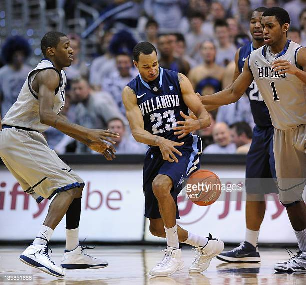 Villanova guard Dominic Cheek looses his dribble and the ball between Georgetown guard Jason Clark left and Georgetown forward Hollis Thompson during...