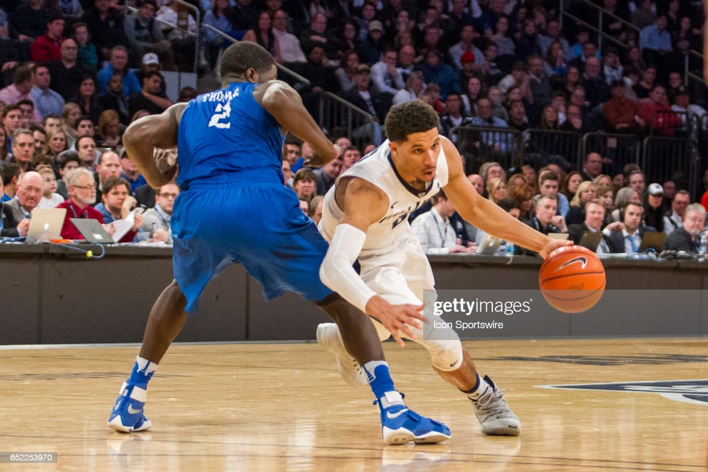 Villanova Guard Josh Hart (3) goes low around Creighton Guard Khyri Thomas (2) during the championship match-up in the BigEast Conference men's basketball tournament featuring the top seeded Villanova Wildcats and the Creighton Bluejays on March 11, 2017, at Madison Square Garden in New York, NY.