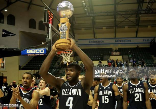 Villanova Wildcats celebrate winning the Advocare Invitational against the Florida State Seminoles at HP Field House on November 25 2018 in Orlando...