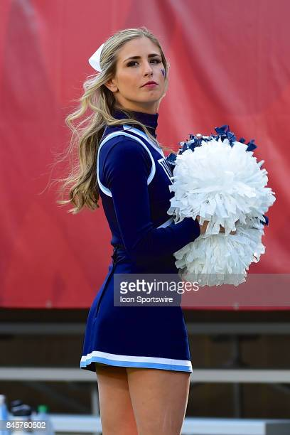 Villanova Wildcats cheerleader looks on during a college football game between the Temple Owls and the Villanova Wildcats on September 9 2017 at...