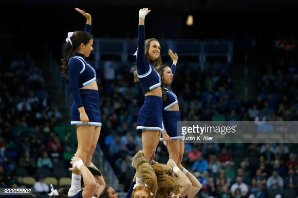 Villanova Wildcats cheerleaders perform against the Alabama Crimson Tide during the first half in the second round of the 2018 NCAA Men's Basketball...