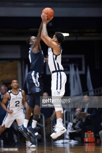 Villanova Wildcats forward Dhamir CosbyRoundtree blocks the shot of Butler Bulldogs forward JordanTucker during the men's college basketball game...