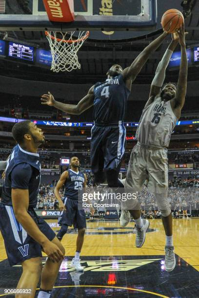 Villanova Wildcats forward Eric Paschall blocks the shot of Georgetown Hoyas center Jessie Govan on January 17 at the Capital One Arena in Washington...