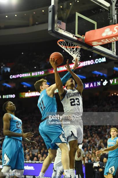Villanova Wildcats forward Jermaine Samuels makes a lay up over Georgetown Hoyas guard Greg Malinowski during the game between the Georgetown Hoyas...