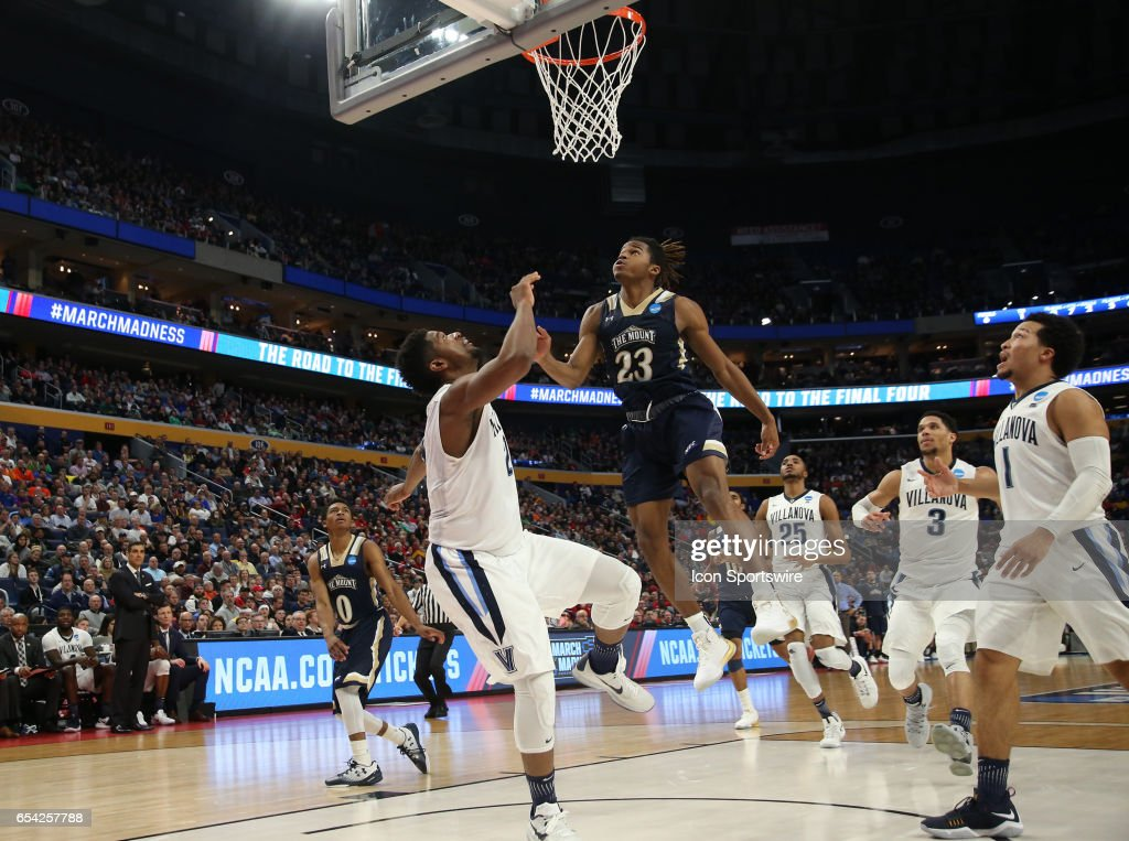 Villanova Wildcats forward Kris Jenkins (2) is fouled by Mount St. Mary's Mountaineers guard Greg Alexander (23) during the NCAA Division I Men's Basketball Championship first round game between Mount St. Mary's Mountaineers and Villanova Wildcats on March 16, 2017 at the Key Bank Center in Buffalo, NY.
