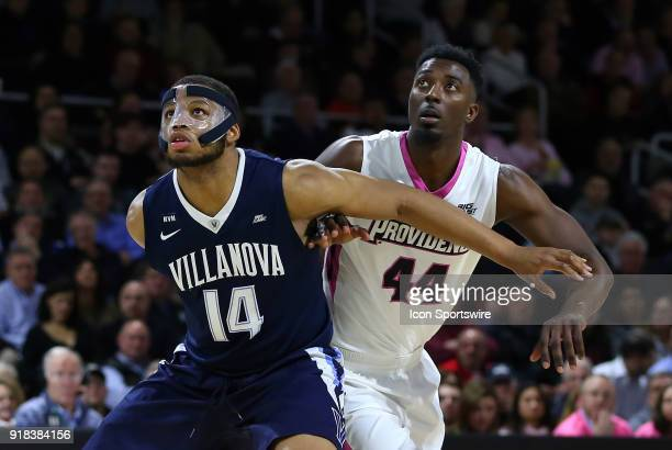 Villanova Wildcats forward Omari Spellman and Providence Friars guard Isaiah Jackson battle for position during a college basketball game between...