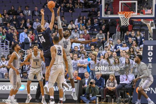 Villanova Wildcats forward Omari Spellman scores over Georgetown Hoyas center Jessie Govan in the second half on January 17 at the Capital One Arena...