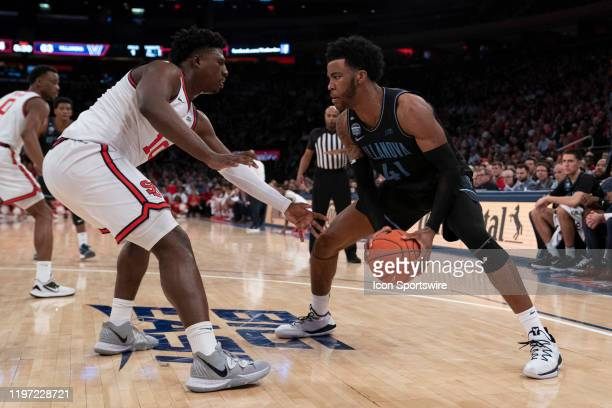 Villanova Wildcats Forward Saddiq Bey looks to make a move with St. John's Red Storm Forward Marcellus Earlington defending during the second half of...