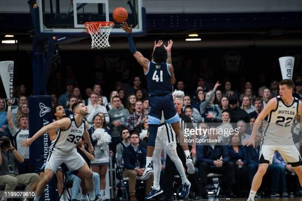 Villanova Wildcats forward Saddiq Bey shoots over Butler Bulldogs forward JordanTucker in the lane during the men's college basketball game between...