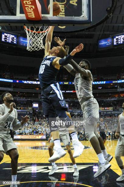 Villanova Wildcats guard Donte DiVincenzo in action against Georgetown Hoyas center Jessie Govan on January 17 at the Capital One Arena in Washington...