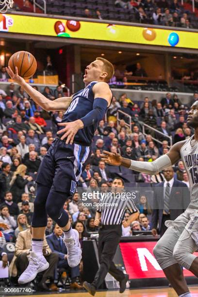 Villanova Wildcats guard Donte DiVincenzo scores in the first half against Georgetown Hoyas center Jessie Govan on January 17 at the Capital One...