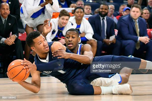 Villanova Wildcats guard Jalen Brunson and DePaul Blue Demons guard Brandon Cyrus battle on the floor for the loose ball during the game between the...