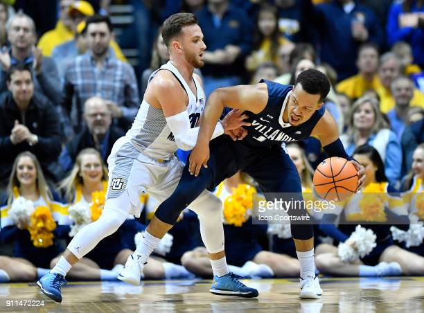 Villanova Wildcats guard Jalen Brunson is fouled by Marquette Golden Eagles guard Andrew Rowsey during the game between the Marquette Golden Eagles...