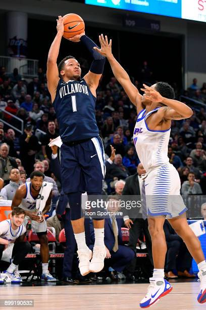 Villanova Wildcats guard Jalen Brunson shoots over DePaul Blue Demons guard Justin Roberts during the game between the DePaul Blue Demons and the...