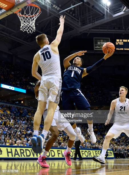 Villanova Wildcats guard Jalen Brunson shoots over Marquette Golden Eagles guard Sam Hauser during the game between the Marquette Golden Eagles and...