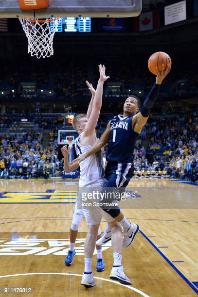 Villanova Wildcats guard Jalen Brunson shoots over Marquette Golden Eagles center Harry Froling during the game between the Marquette Golden Eagles...