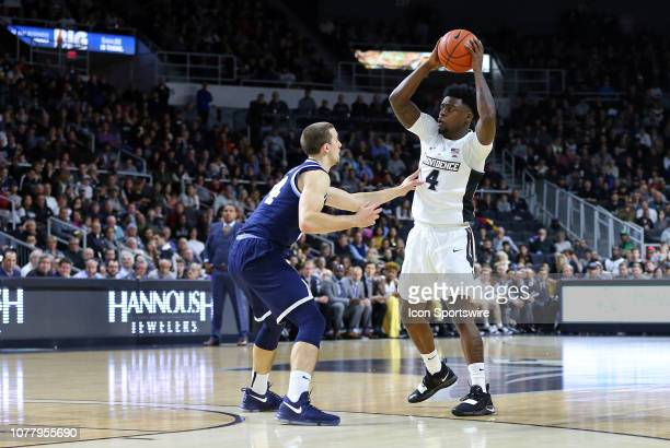 Villanova Wildcats guard Joe Cremo defends Providence Friars guard Maliek White during a college basketball game between Villanova Wildcats and...