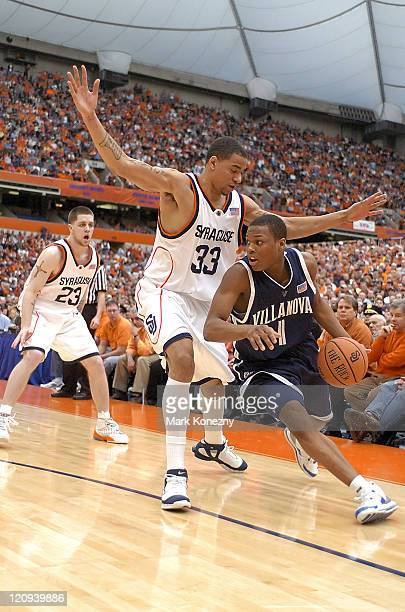 Villanova Wildcats guard Kyle Lowry drives the ball against Syracuse Orange forward Terrence Roberts during a game at the Carrier Dome in Syracuse...