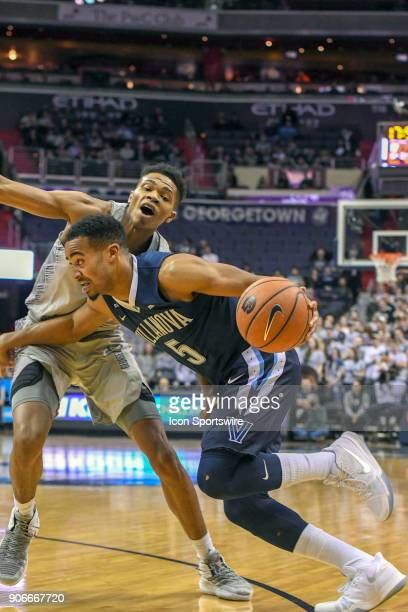 Villanova Wildcats guard Phil Booth drives on Georgetown Hoyas forward Jamorko Pickett in the first half on January 17 at the Capital One Arena in...