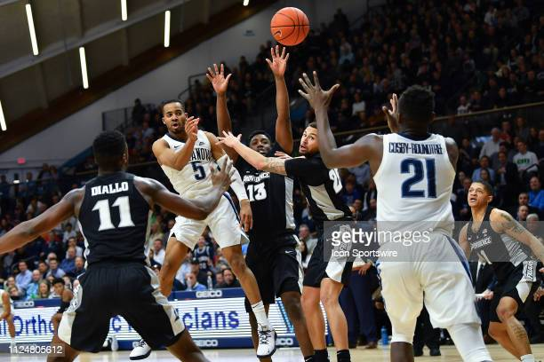 Villanova Wildcats guard Phil Booth passes to Villanova Wildcats forward Dhamir CosbyRoundtree during the college basketball game between the...