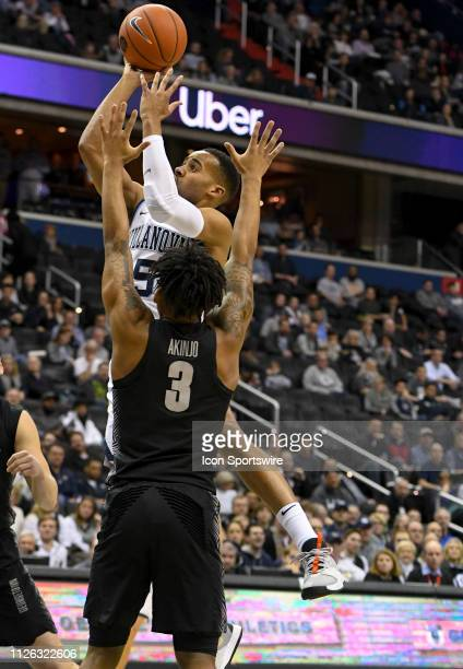 Villanova Wildcats guard Phil Booth scores in the first half against Georgetown Hoyas guard James Akinjo on February 20 at the Capital One Arena in...