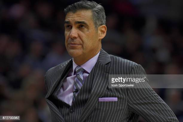 Villanova Wildcats head coach Jay Wright looks up eyeing the clock during the college basketball game between the Columbia Lions and the Villanova...