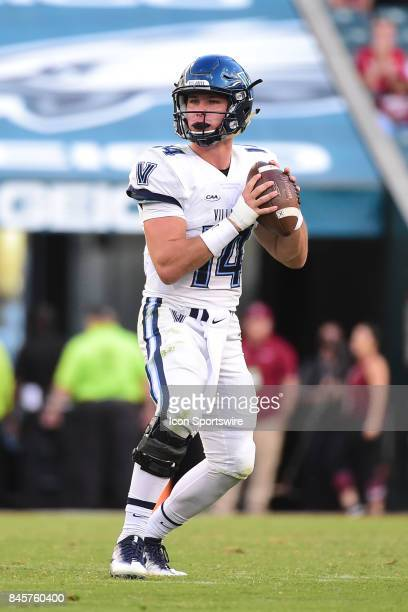 Villanova Wildcats quarterback Zach Bednarczyk drops back to pass during a college football game between the Temple Owls and the Villanova Wildcats...
