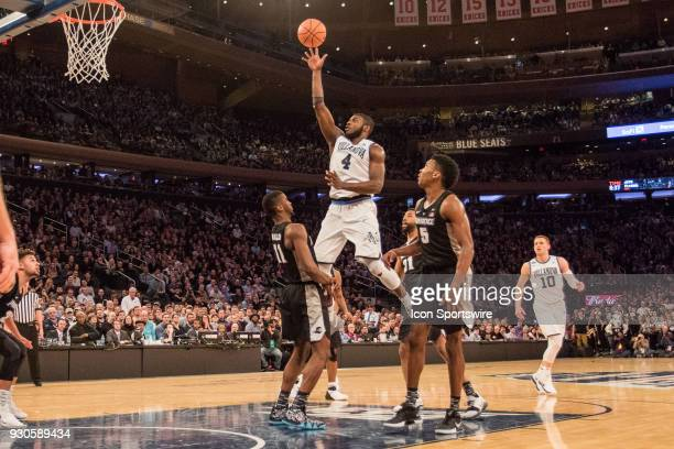 Villanova's Forward Eric Paschall shoots over Providence's Guard Alpha Diallo during the second half of the BigEast Championship game featuring the...